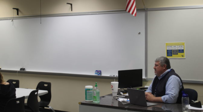 Profile: Business teacher lucas builds relationships with students, peers